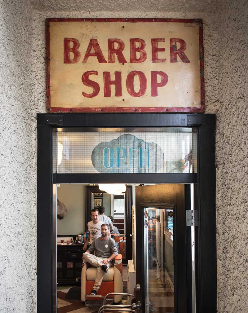 Looking through the front door of Belmont Barber Shop Vancouver